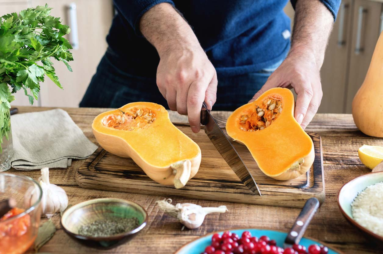Cutting butternut squash, which is full of health benefits