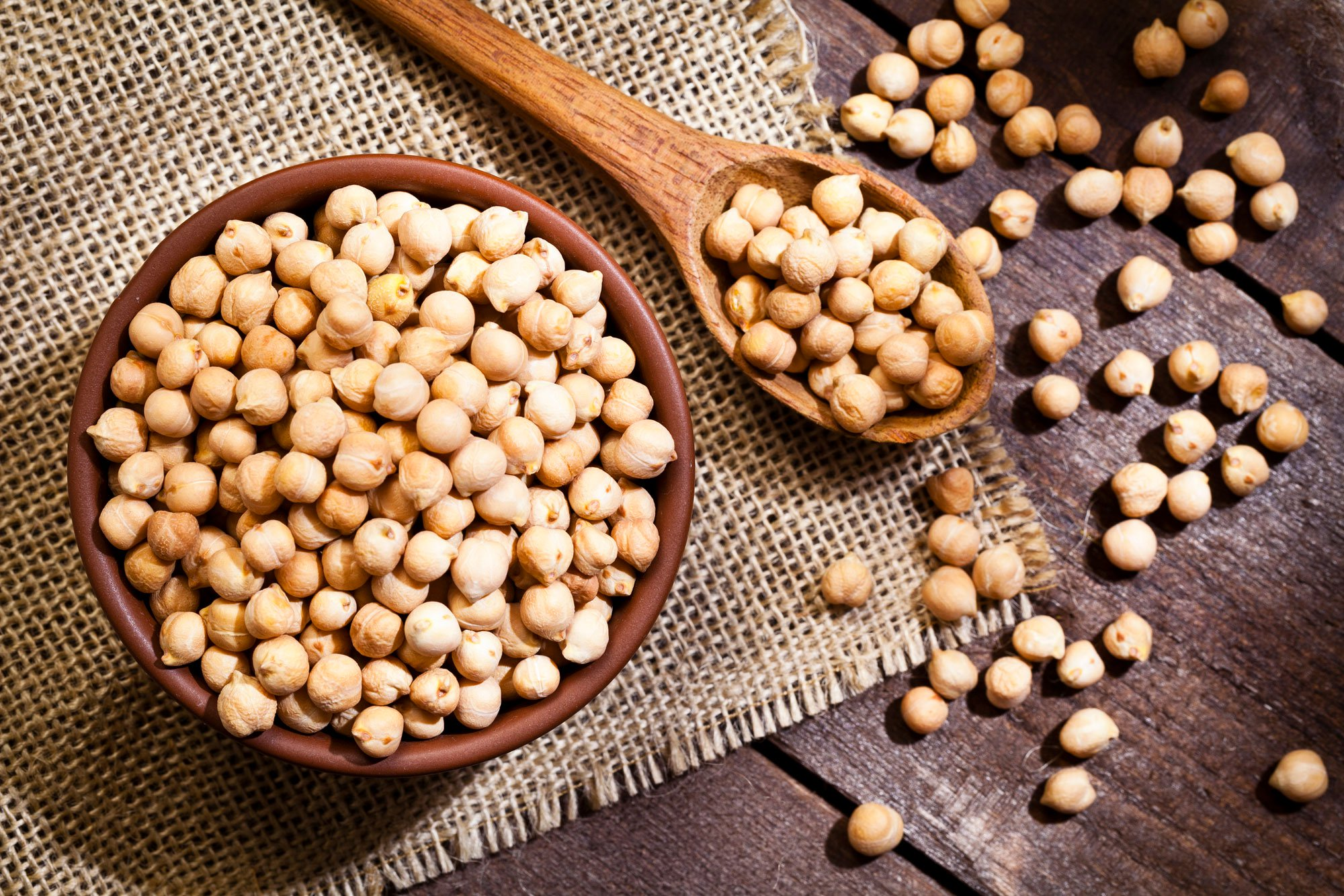 chickpeas in a bowl and wooden spoon