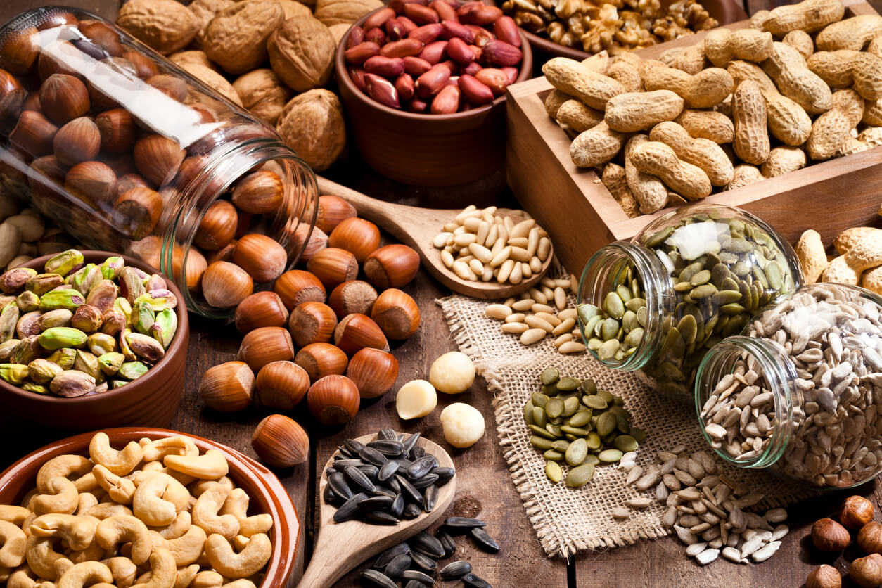 assortment of nuts on rustic wood table