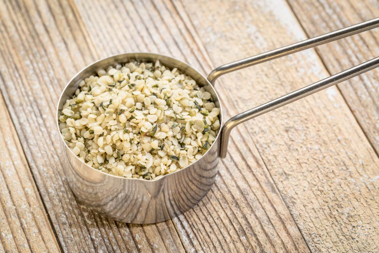 Hemp seeds in measuring cup