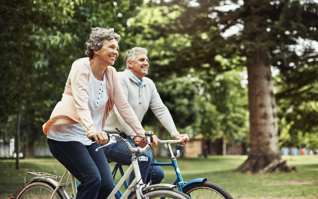 mature couple enjoying a bike ride together