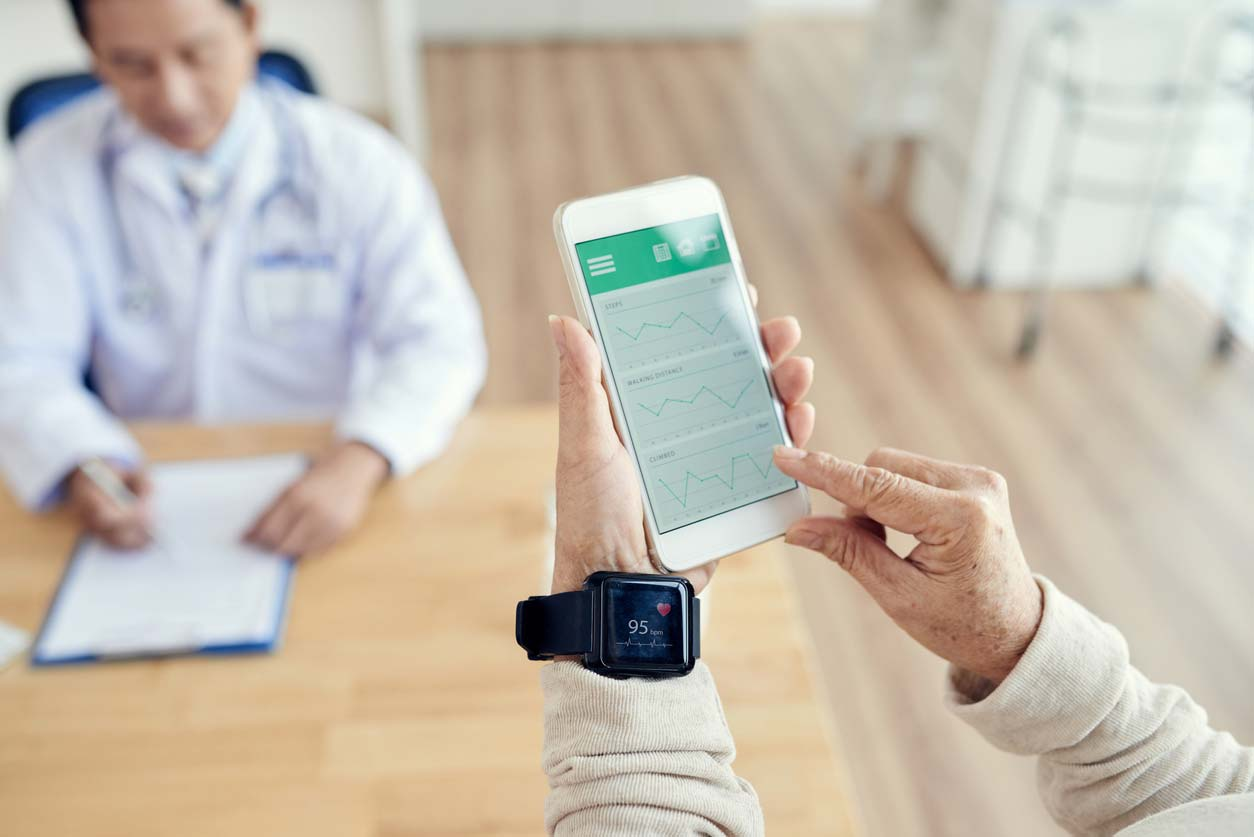 patient checking heart rate with health tracker