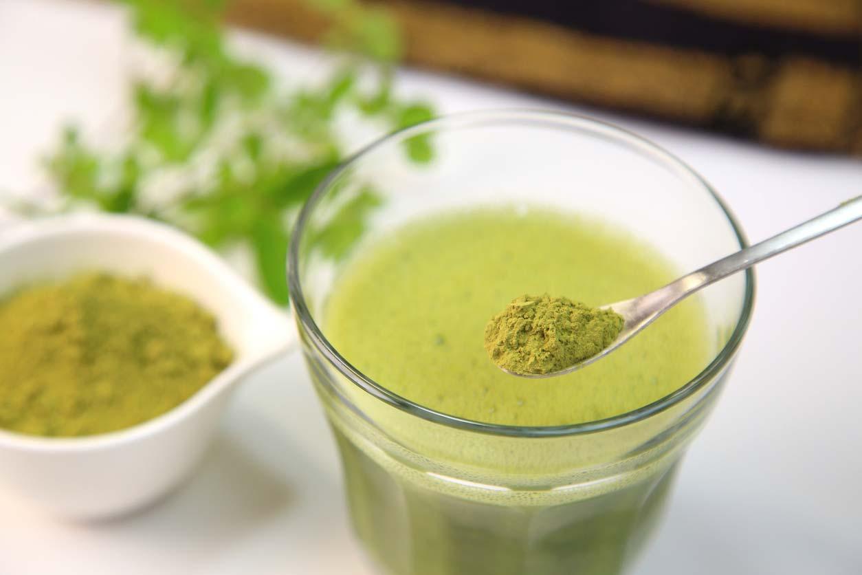 moringa powder being stirred into drink