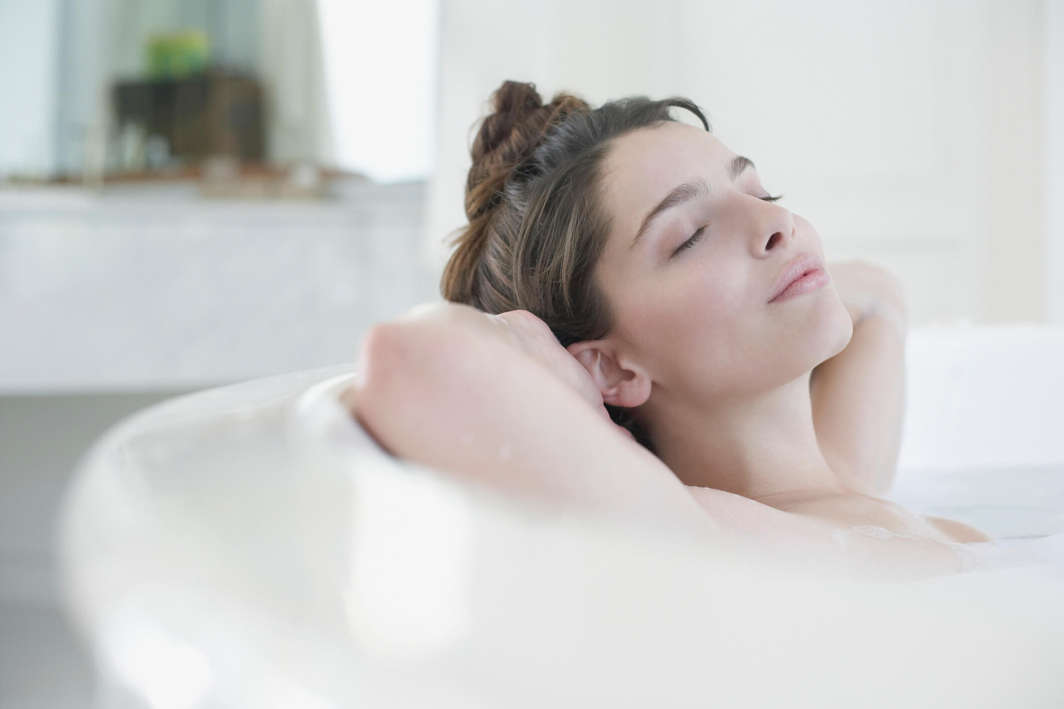 A woman relaxing in a bathtub