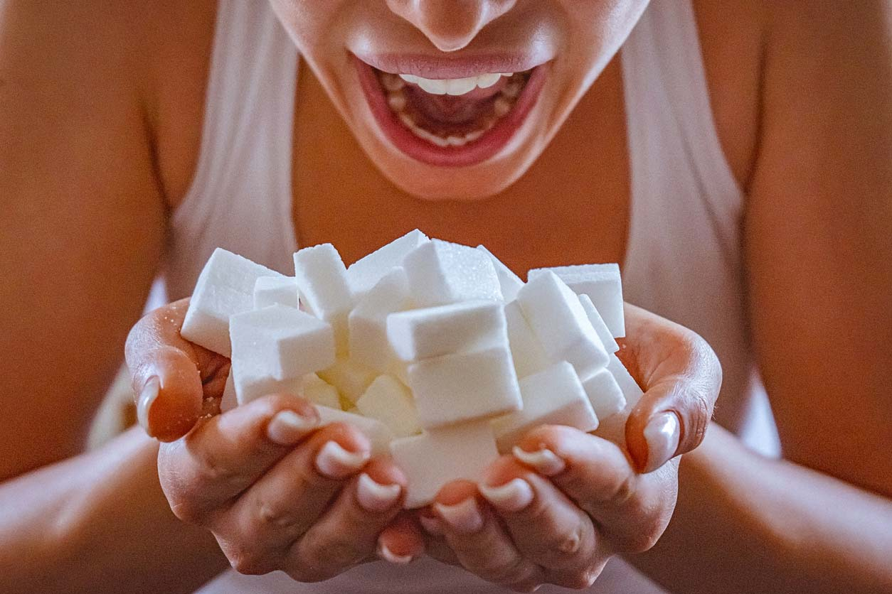 close up of woman holding a hands full of sugar cubes