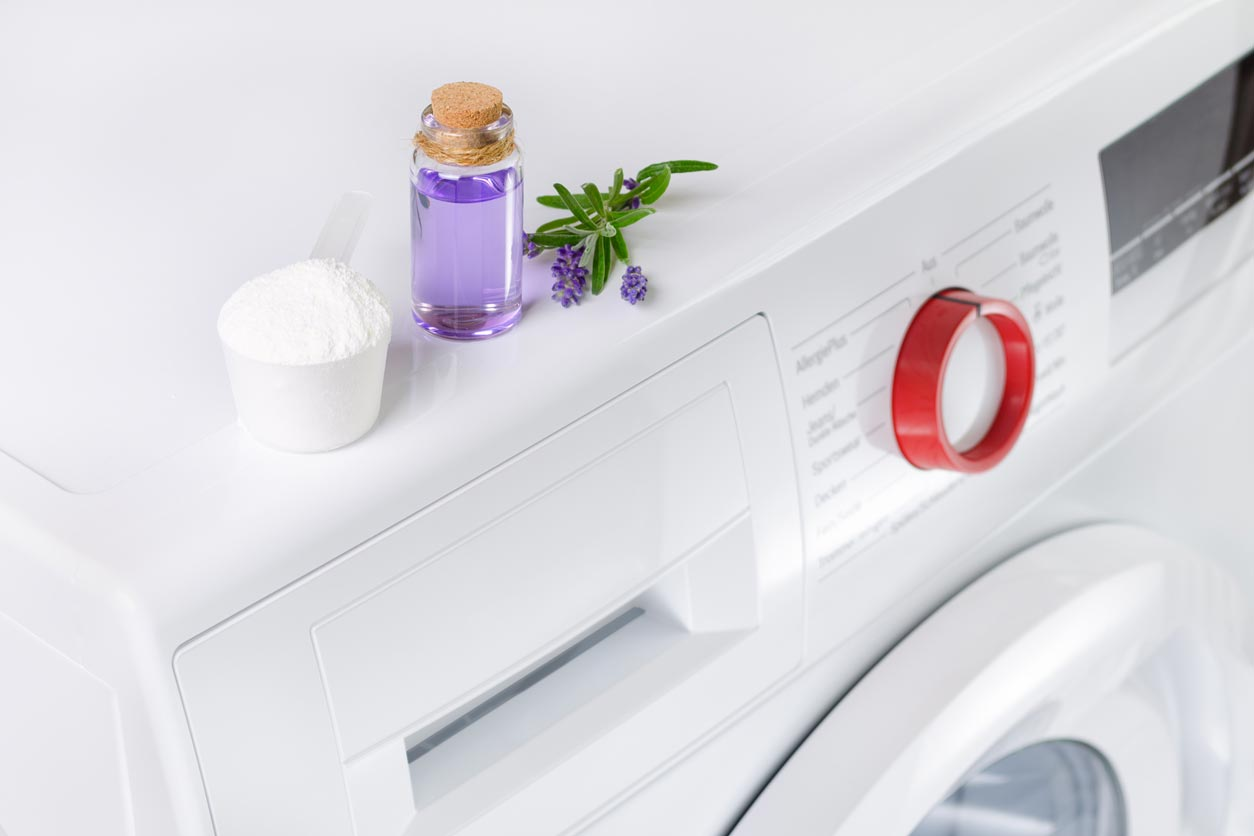 Natural laundry detergent and essential oil on washer
