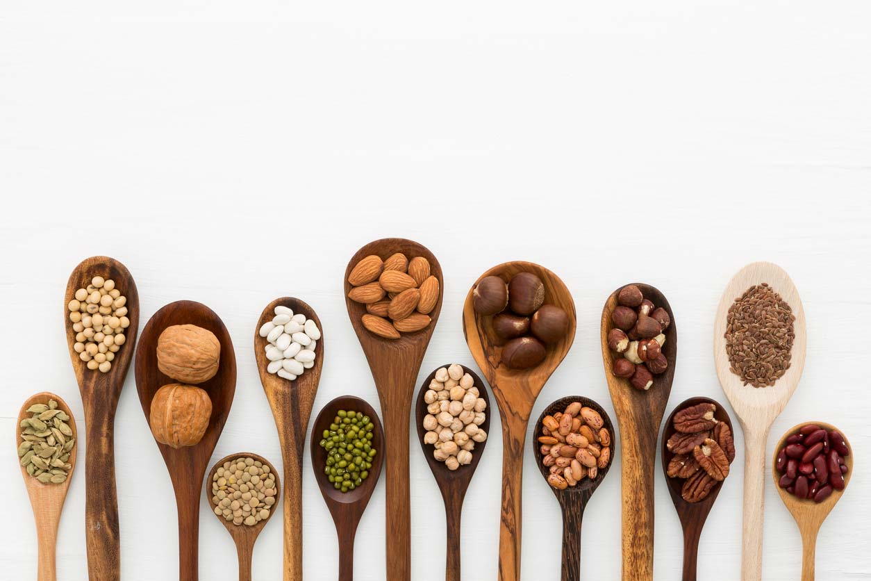 Plant-based protein sources for vegan bone health in wooden spoons