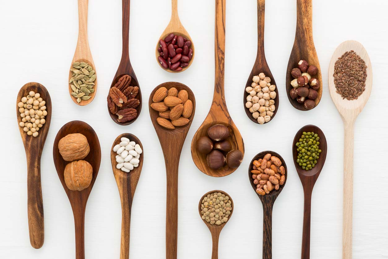 Wooden spoons holding foods high in phytic acid that converts to phytates