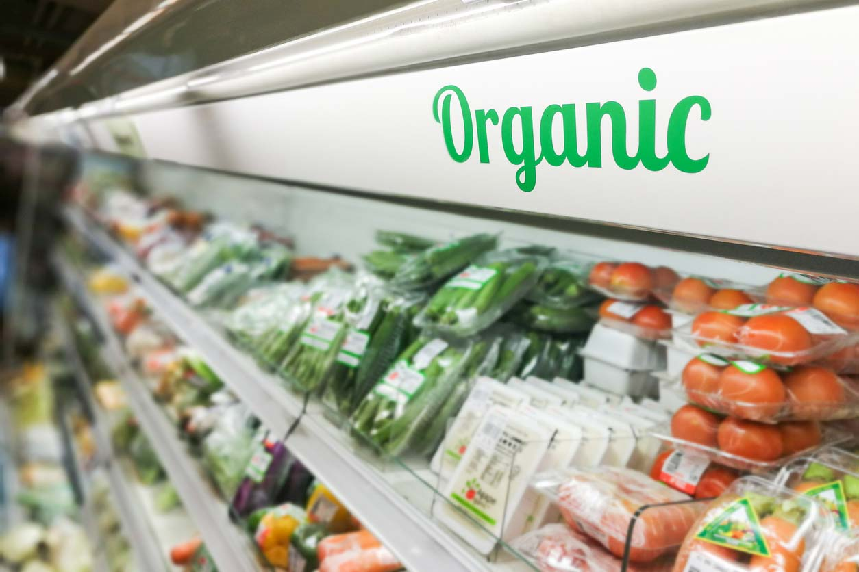 organic signage in refrigerated produce aisle