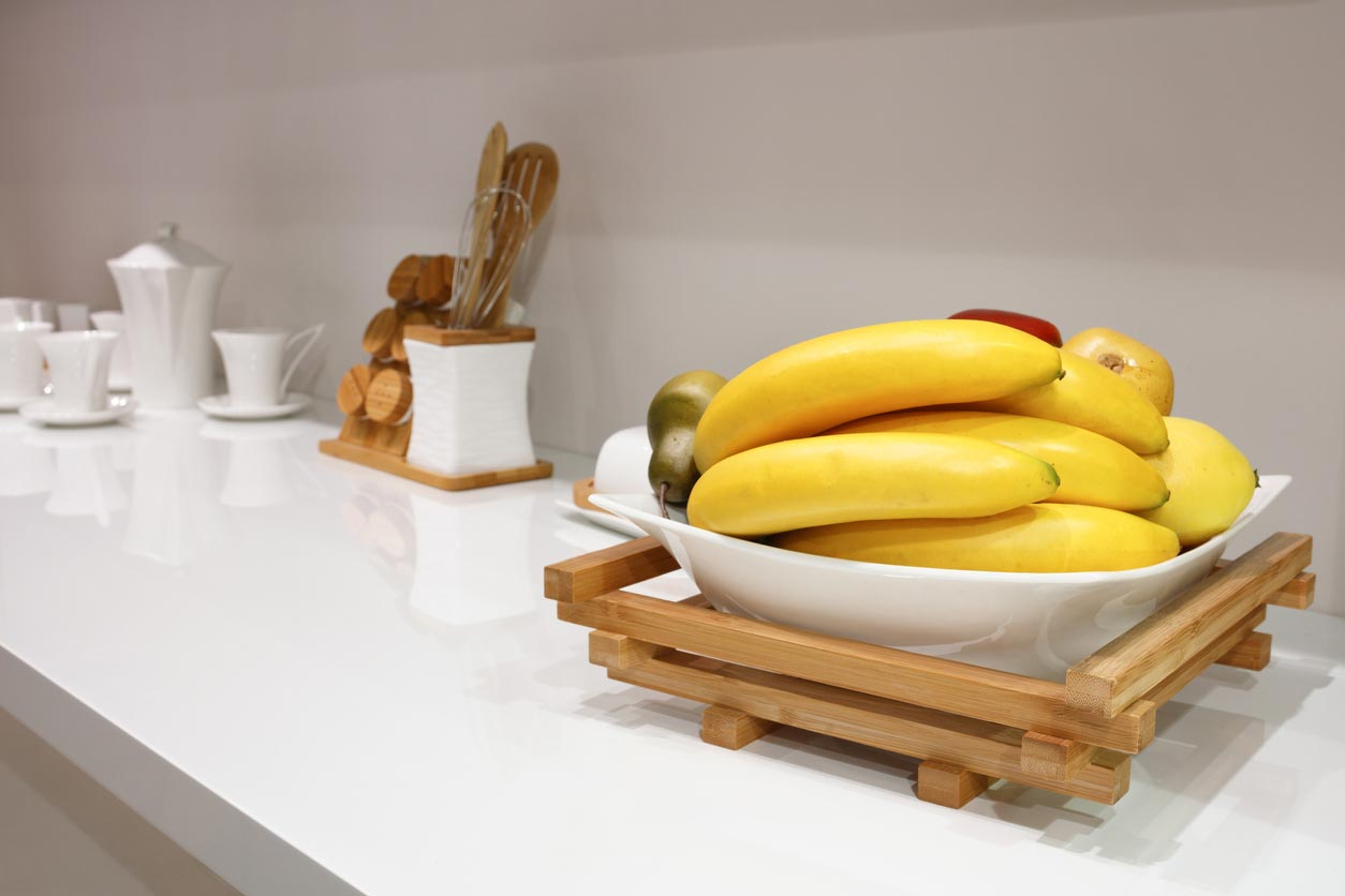 bananas in bowl on kitchen counter