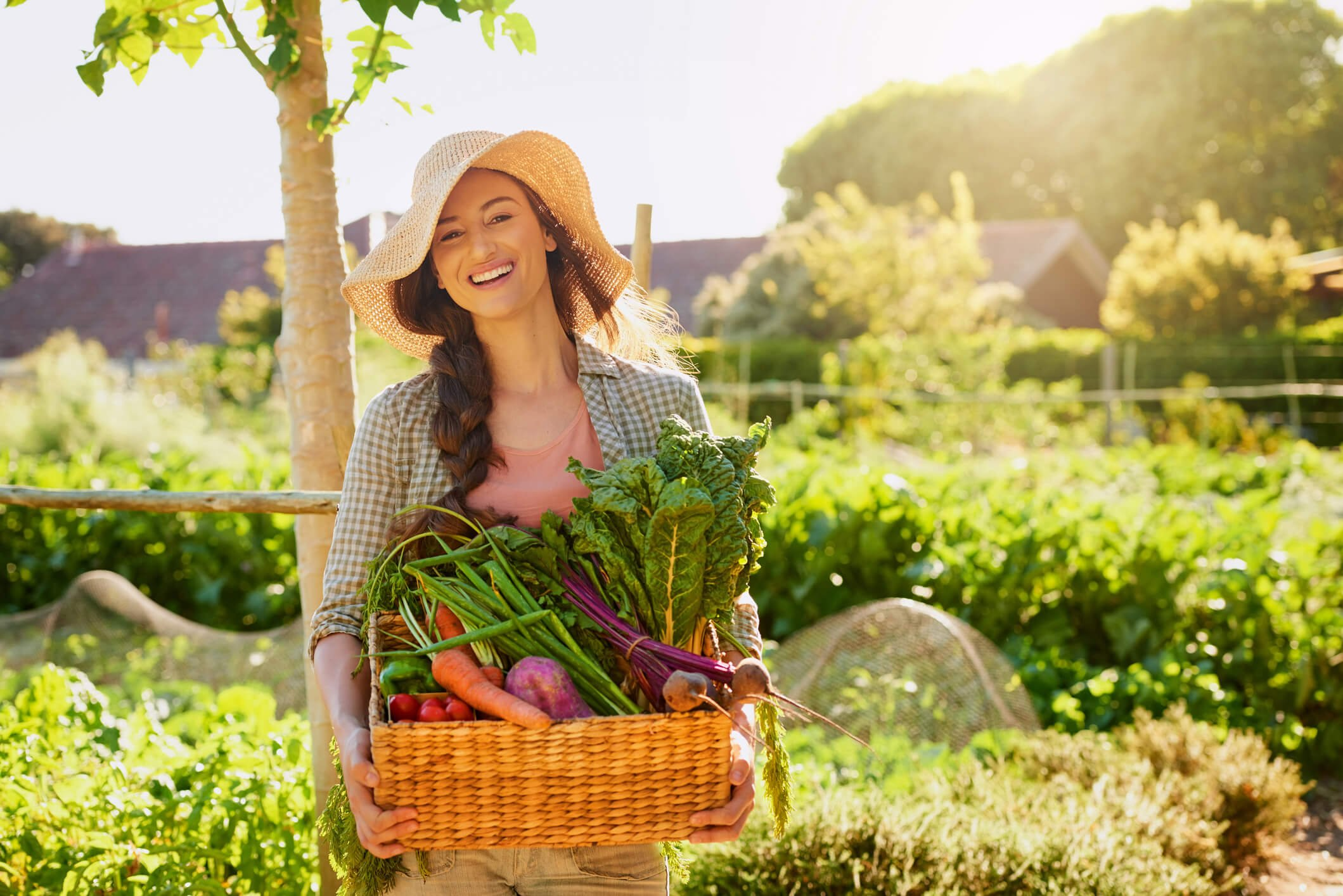 Woman carrying basket of spring produce