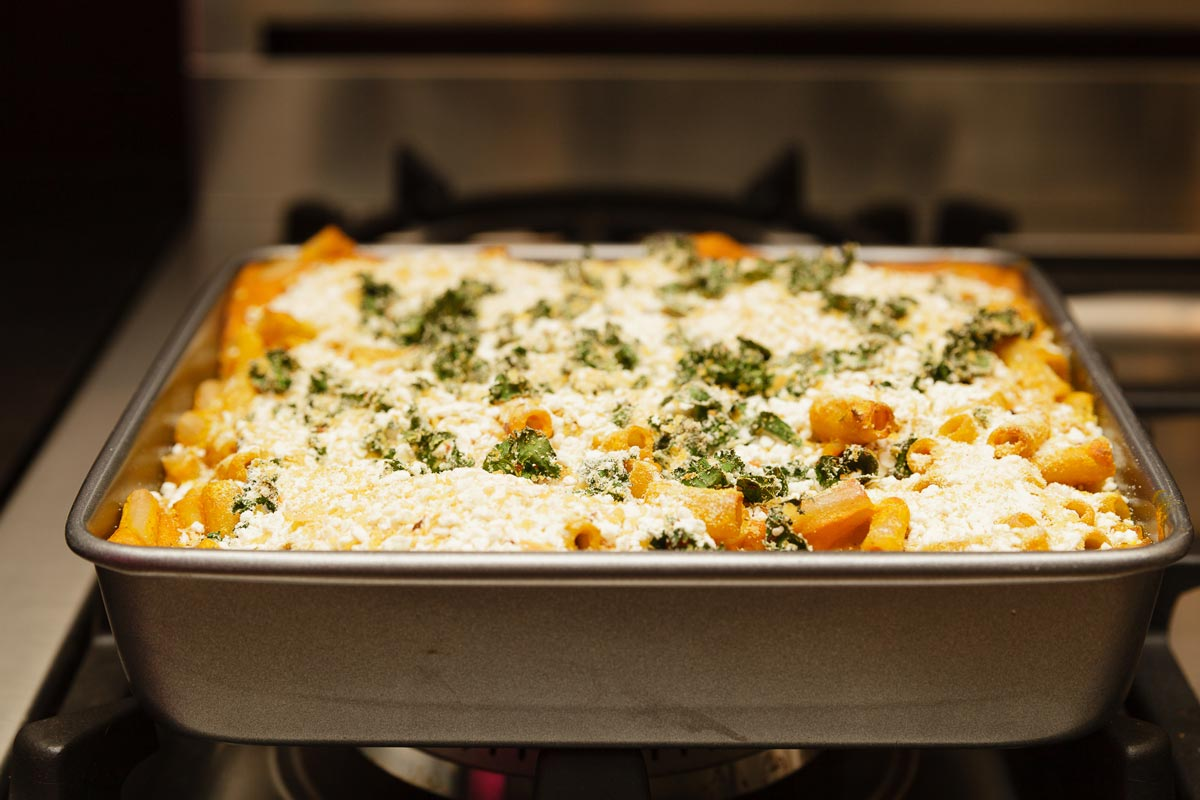 creamy vegan pumpkin mac and cheese in oven