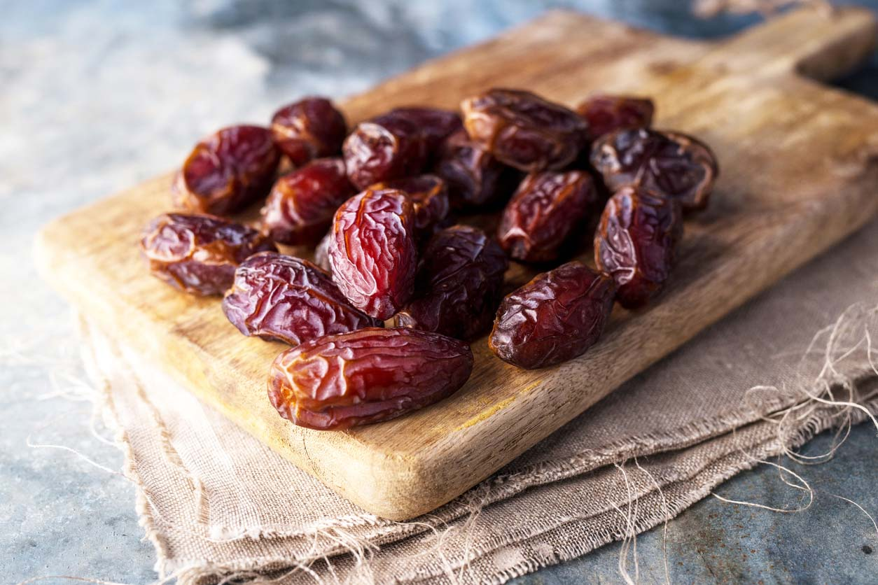 Dates on cutting board - The top vegan substitution for sugar