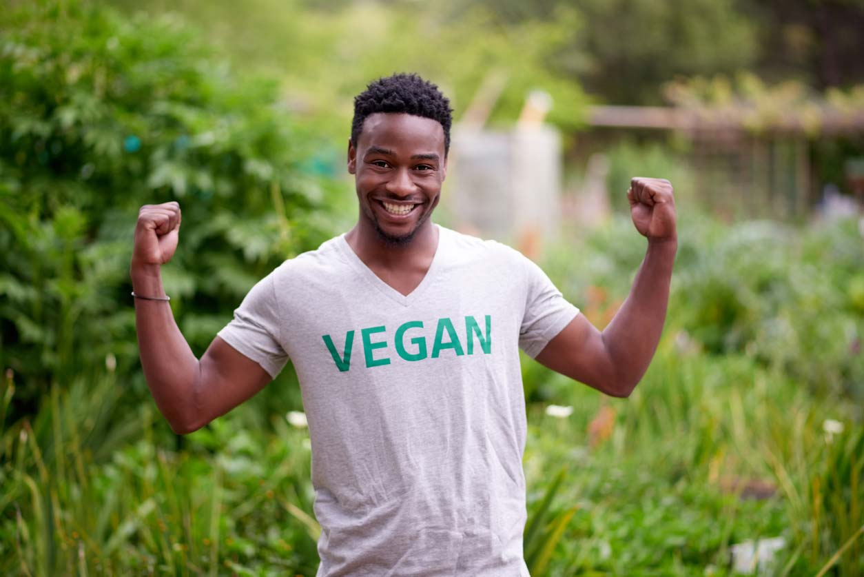 man of color wearing tshirt with word vegan