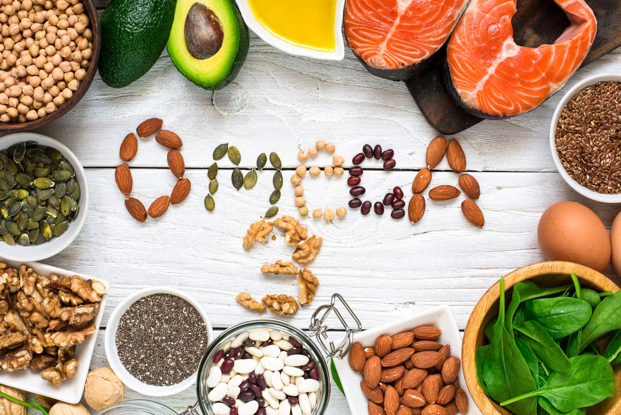 foods rich in omega-3 fatty acids with word spelled out