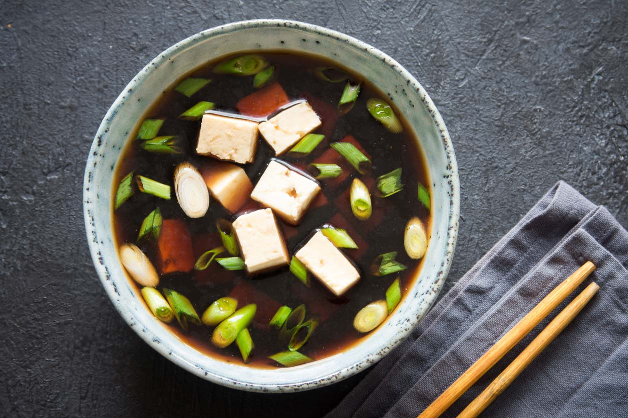 Miso soup with tofu in bowl
