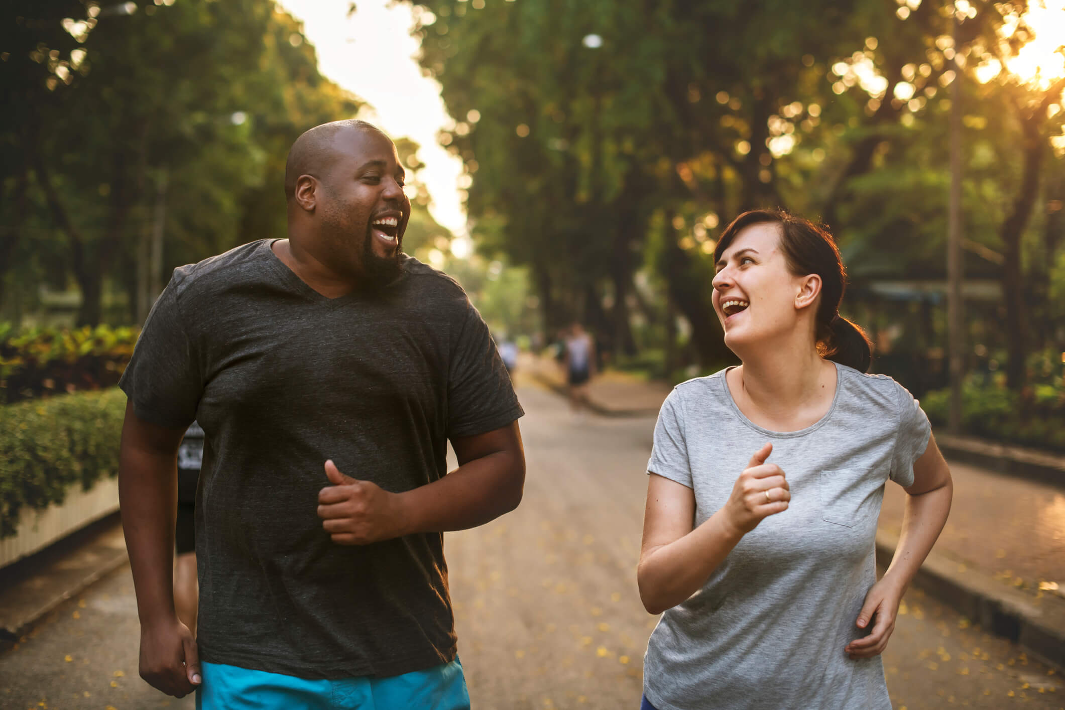 A man and woman running in a park