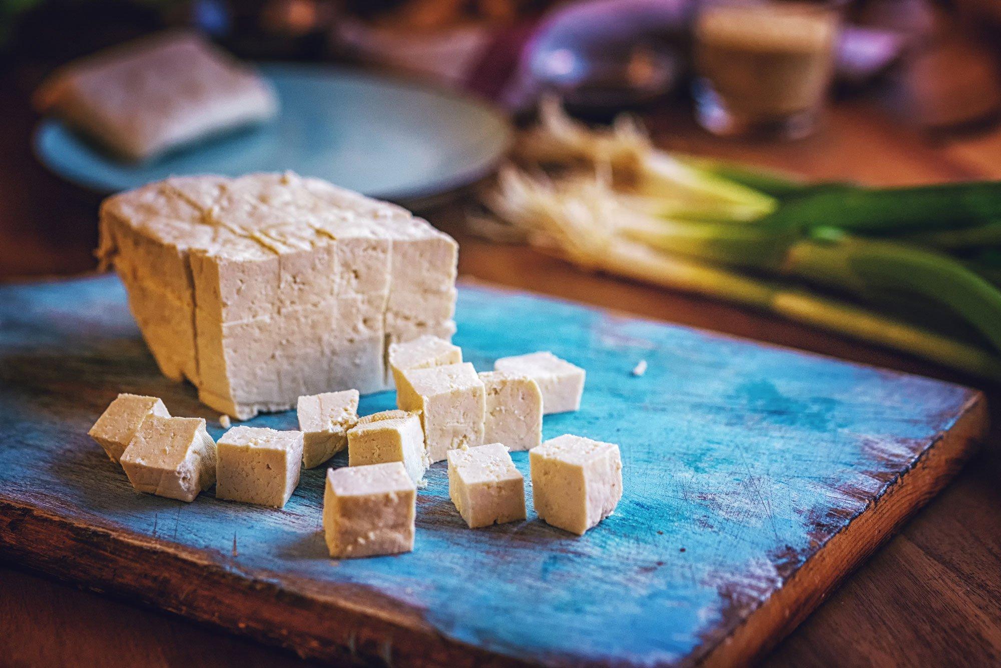 cut tofu on a cutting board