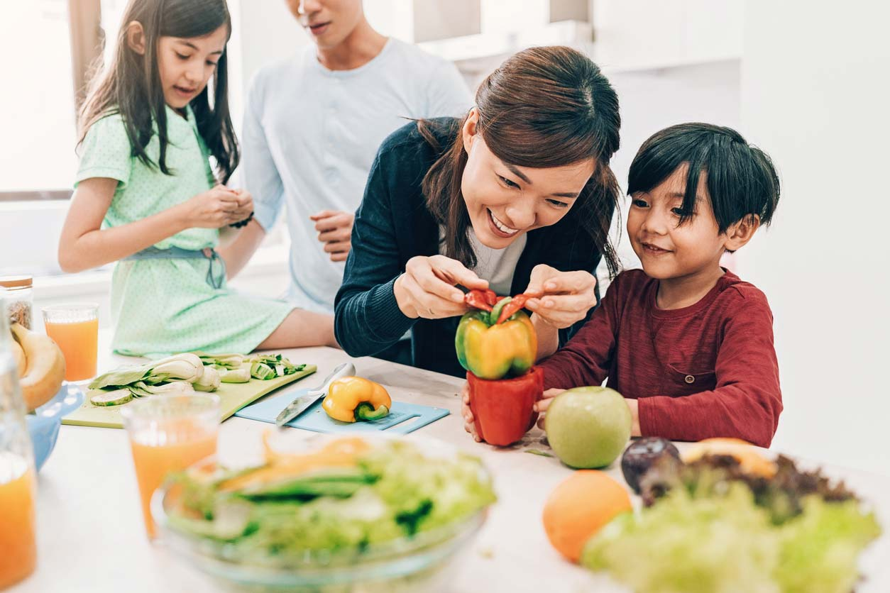 family preparing healthy salad together