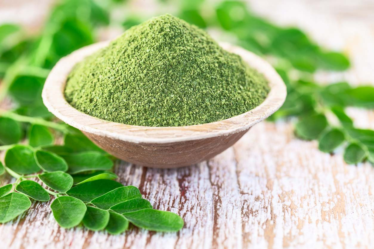 moringa powder in coconut bowl