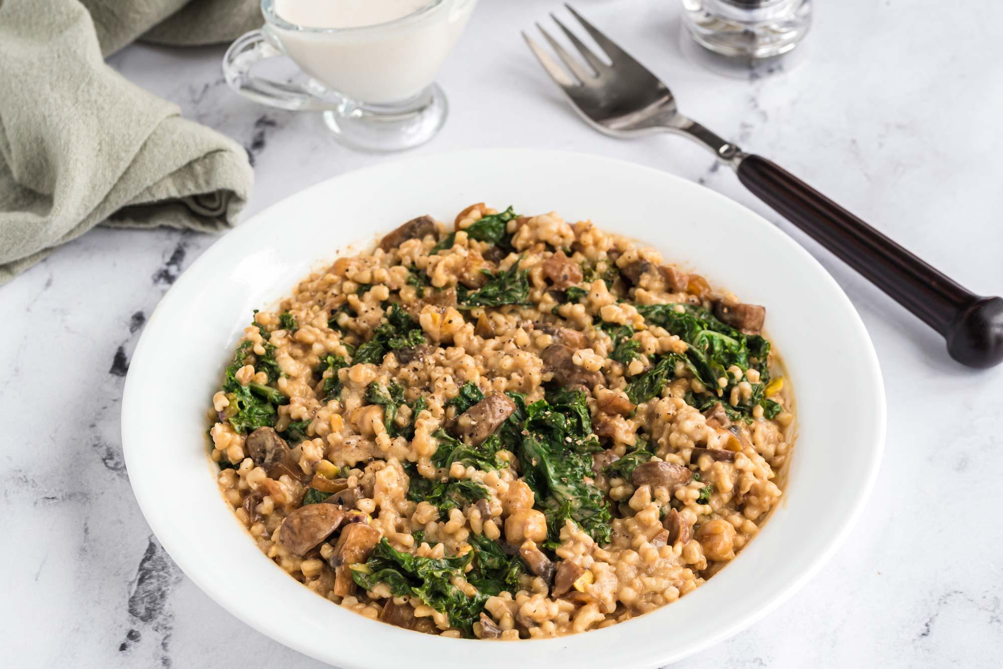 kale and mushroom oat groats in bowl