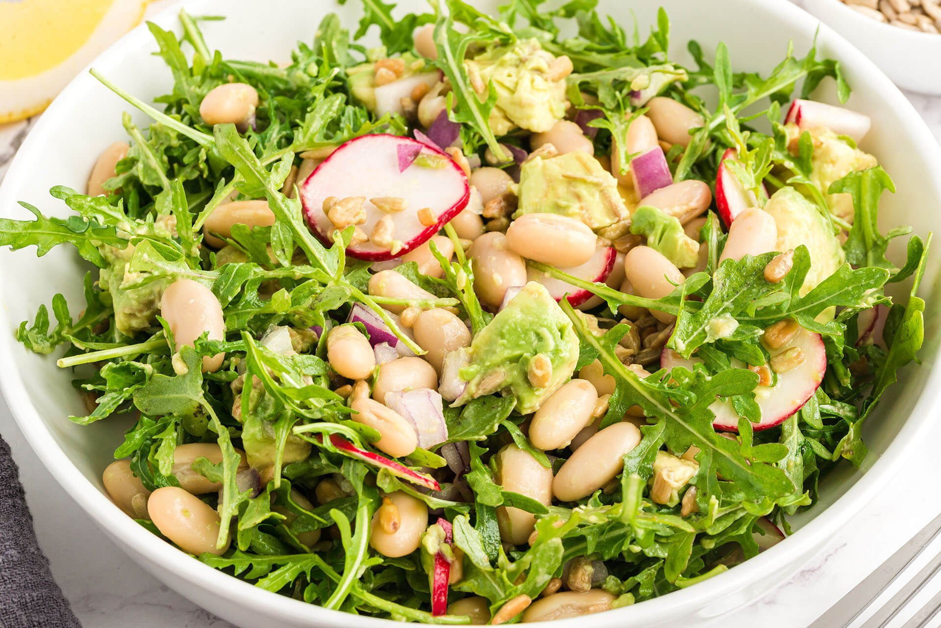 lemony arugula white bean and sunflower salad