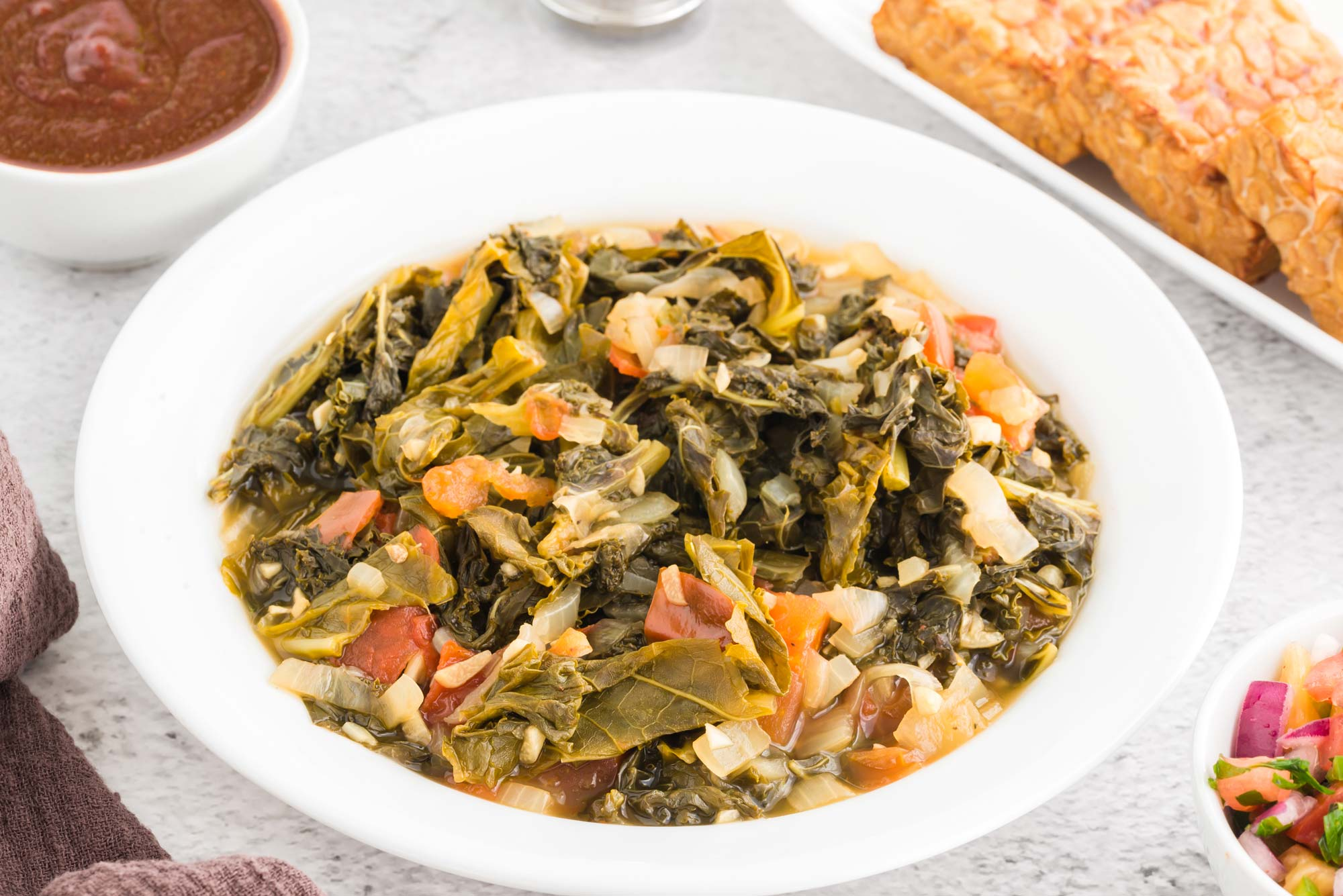 lemony braised kale and tomatoes in bowl