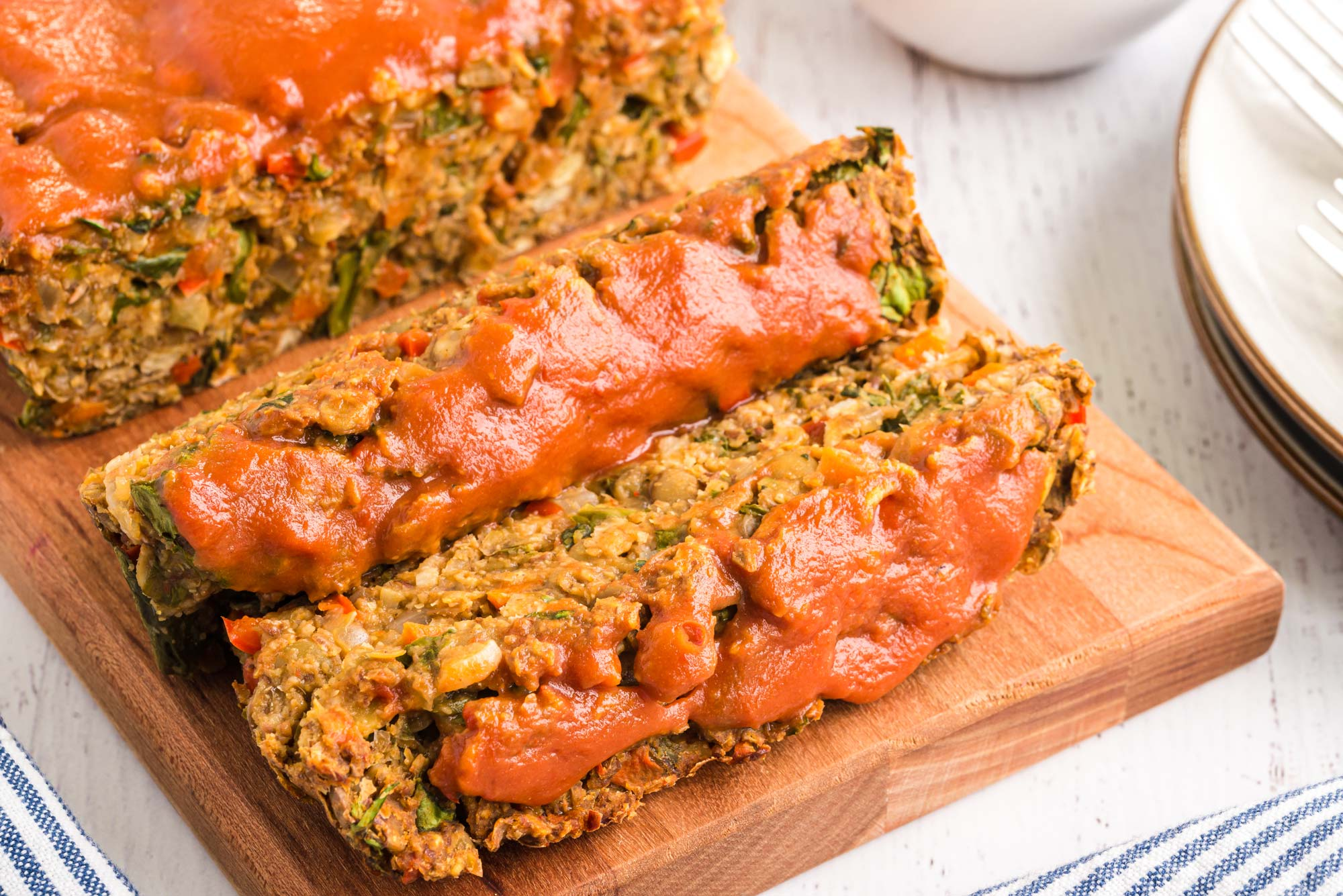 lentil flax loaf slices on cutting board