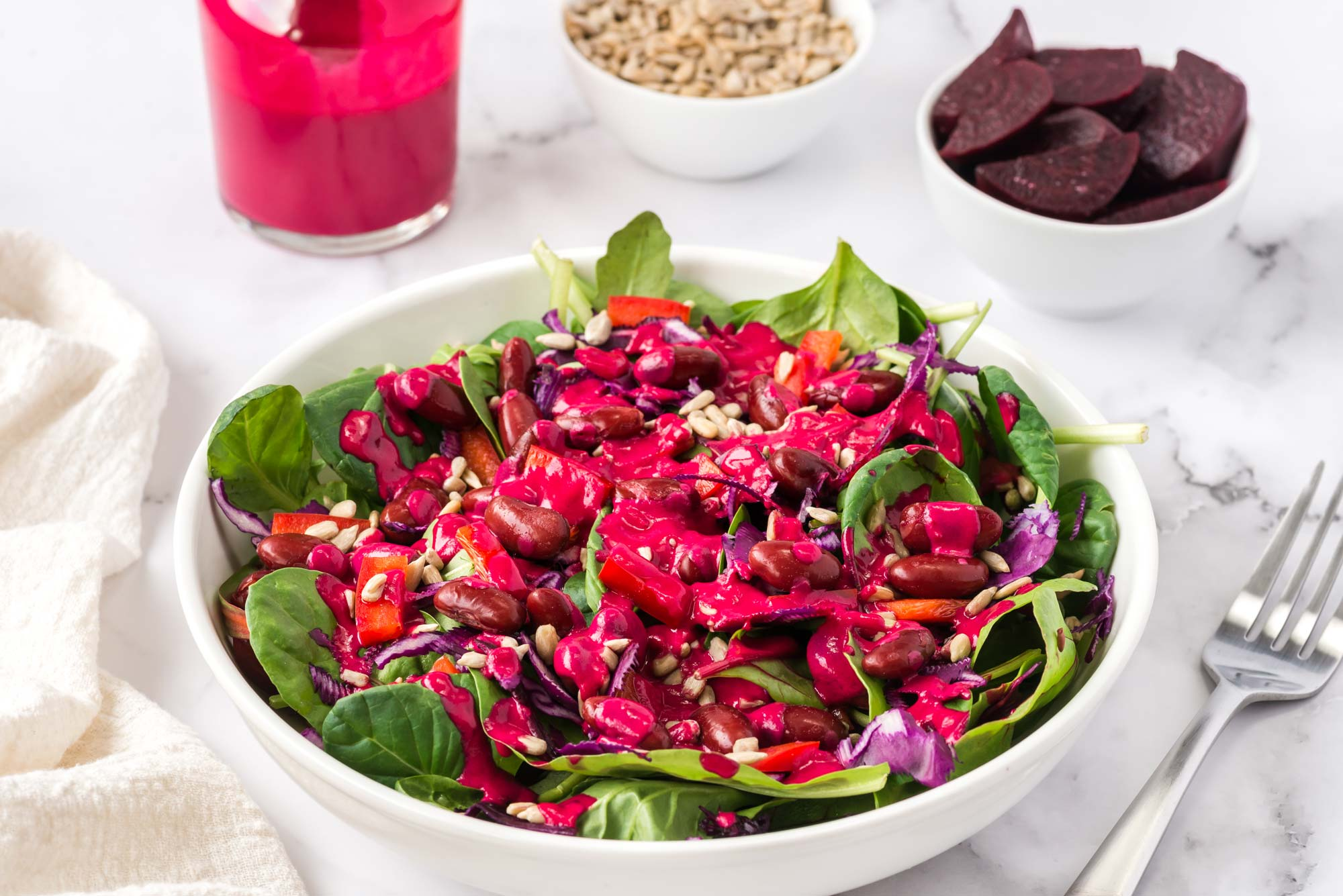 heart beets dressing on a salad in bowl