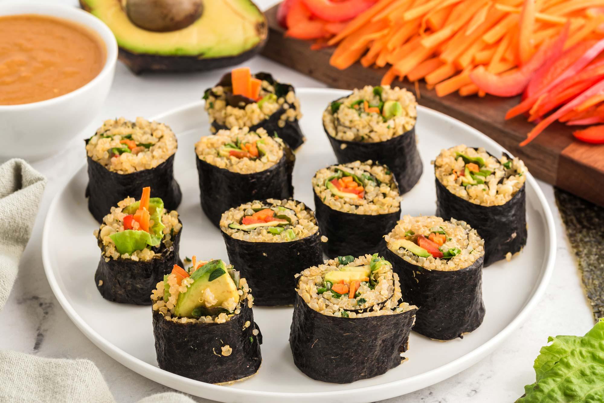 rainbow millet roll with miso peanut sauce on plate