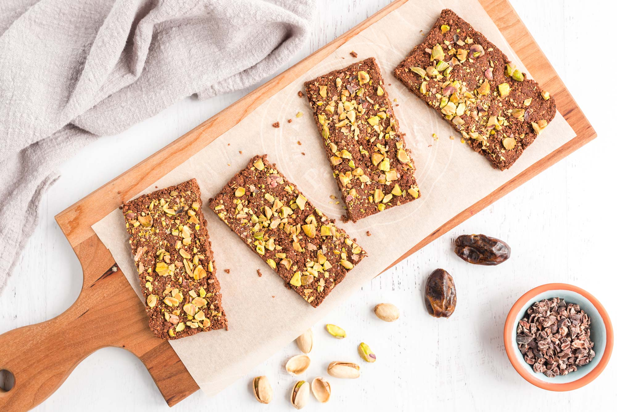 Raw dark chocolate bars with pistachios