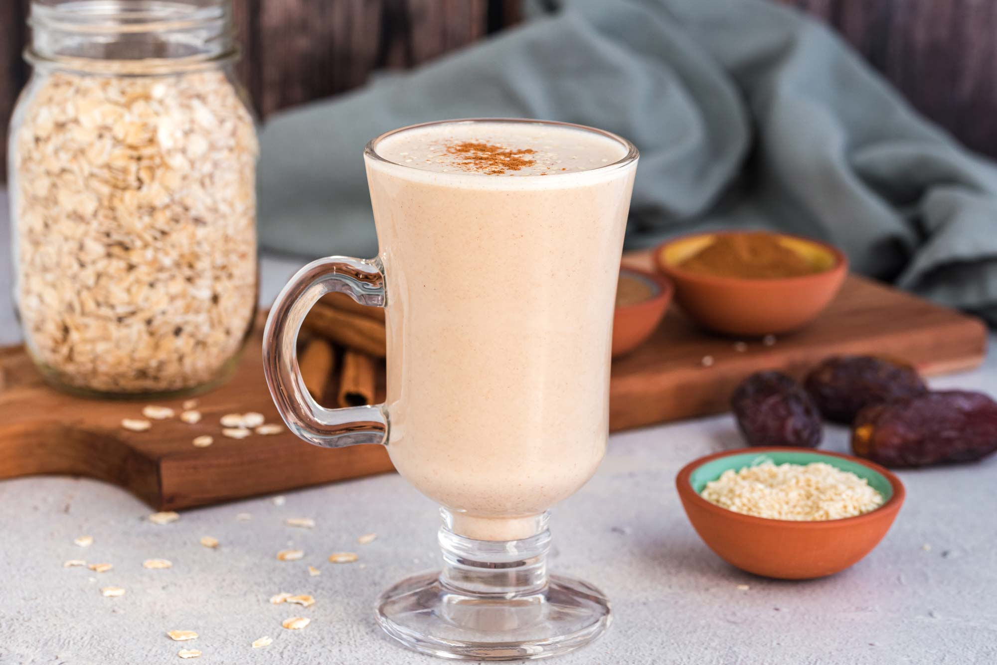 sweet and nutty oat milk with cinnamon in glass