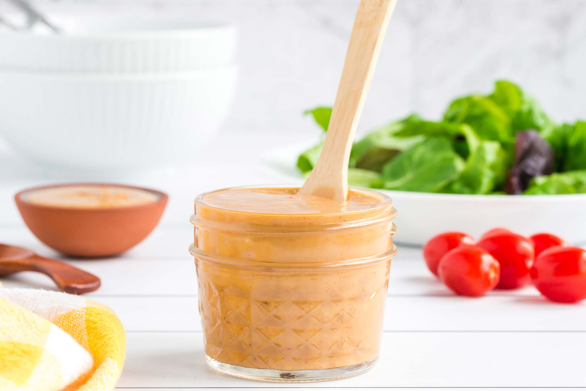 Healthy sweet and savory almond butter salad dressing