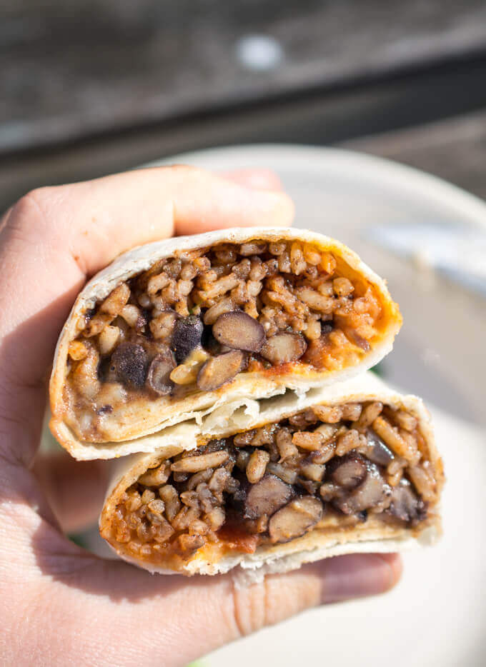 vegan burritos with cauliflower queso and black beans