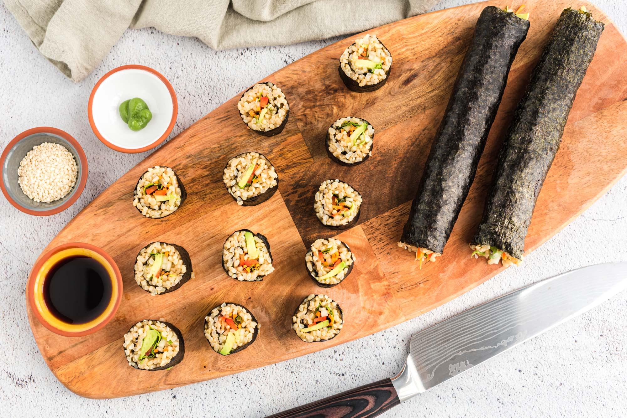 veggie nori rolls on cutting board